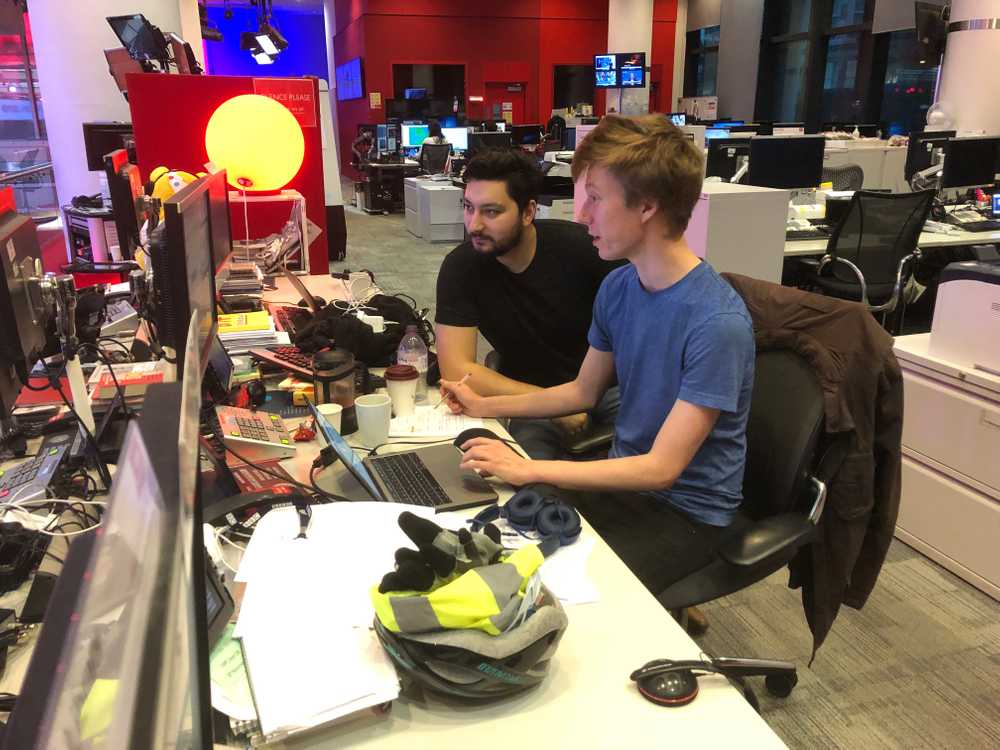 Labbers Tom Francis-Winnington and Joe Whitwell survey the queue of stories in the newsroom