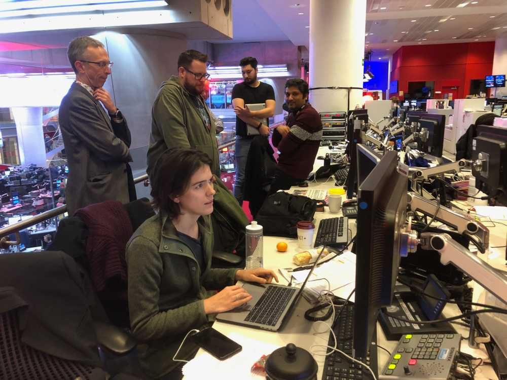 The team in the newsroom as the night draws to a close.